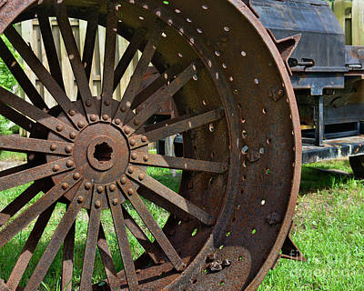 Photograph - Rusty Wheel by Olga Hamilton