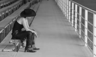 Photograph - Sad Cowgirl by Brian Kinney