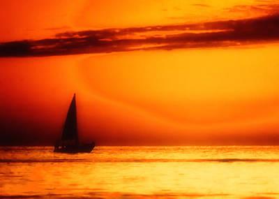 Sailboat In Orange Art Print by Lyle  Huisken