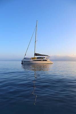 Photograph - Sailing Catamaran In Early Morning Light In The Whitsundays by Keiran Lusk