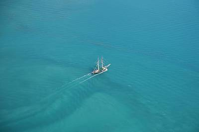 Photograph - Sailing In The Whitsundays by Keiran Lusk