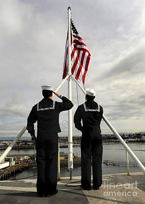 Flagpole Photograph - Sailors Raise The National Ensign by Stocktrek Images