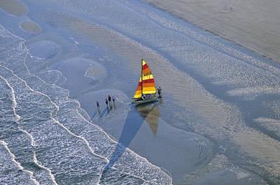 Sailors Take To The Ocean While Art Print by Kenneth Garrett