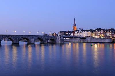Sint Servaasbrug Photograph - Saint Servatius Bridge And Wyck In Maastricht At Dusk by Merijn Van der Vliet