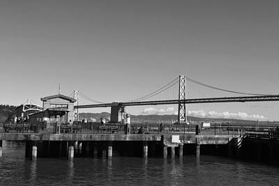 Photograph - San Francisco - Oakland Bay Bridge - Black And White Pier View by Matt Harang