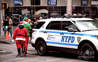 Photograph - Santa And His Elf by John Rizzuto