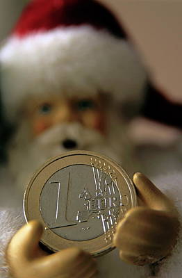 Santa Claus Doll Holding Out A Euro Coin Print by Sami Sarkis