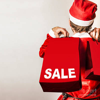 Santa Helper With Gifts At Christmas Shopping Sale Art Print