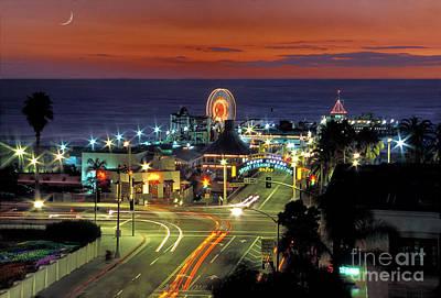 Photograph - Santa Monica Pier Lighted Sunset by David Zanzinger