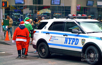 Photograph - Santa With The Nypd by John Rizzuto