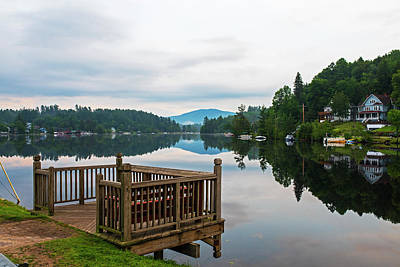 Photograph - Saranac Lake Wooden Deck Reflection On The Calm Lake by Toby McGuire