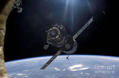 Movie Tees - Satellite Orbiting Around Earth by Stocktrek Images