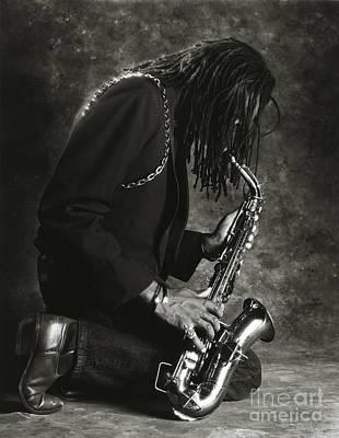 Saxophones Photograph - Sax Player 1 by Tony Cordoza