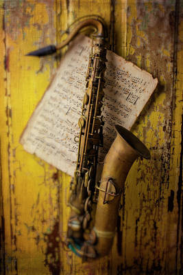 Sheet Music Photograph - Saxophone Hanging On Old Wall by Garry Gay