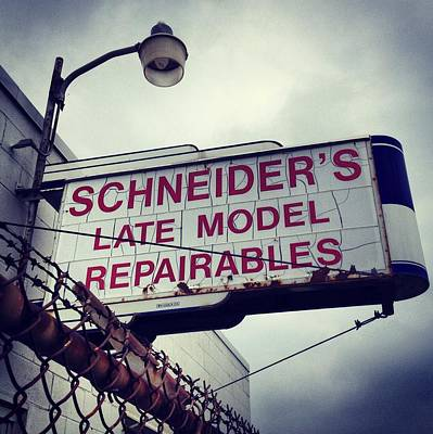 Photograph - Schneider Auto Parts Sign by Chris Brown