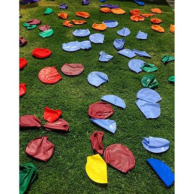 Photograph - School Carnival Swimming Caps Left Out by Paul Dal Sasso
