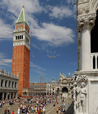 Venice Photograph - Sculpture Of Eve Overlooking Crowds Of Tourists In St Marks Squa by Reimar Gaertner
