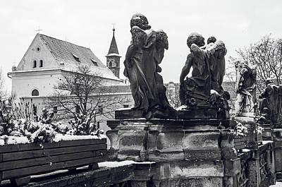 Photograph - Sculptures Of Cherubs In Loreta Complex. Snowy Walk In Prague by Jenny Rainbow