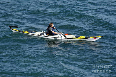 Kayak Photograph - Sea Kayak Man Kayaking Off The Coast Of Dorset England Uk by Andy Smy