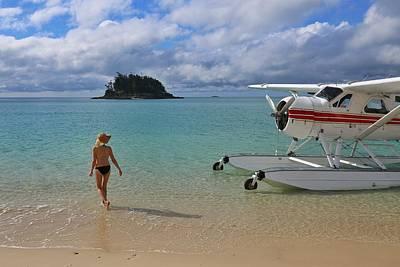 Photograph - Sea Plane And Woman On Beach In The Whitsundays by Keiran Lusk