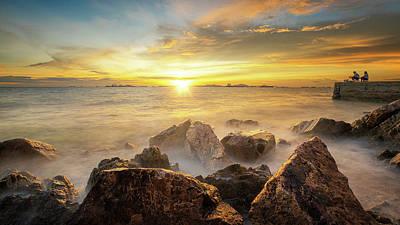 Photograph - Sea Sand Rock Beach And Sunset by Anek Suwannaphoom