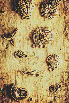 Seashell Shaped Pendants On Wooden Background Print by Jorgo Photography - Wall Art Gallery