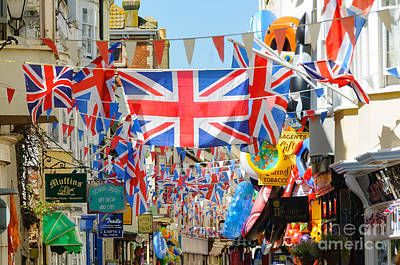Photograph - Seaside Shops And Flags by Colin Rayner