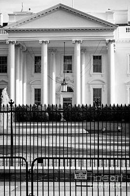 Whitehouse Wall Art - Photograph - security fencing and restricted area sign outside north facade of the White House Washington DC USA by Joe Fox