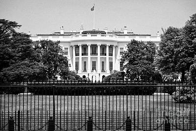 Whitehouse Wall Art - Photograph - security fencing outside the southern facade of the white house Washington DC USA by Joe Fox