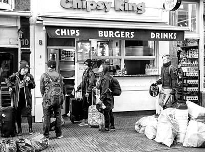 Photograph - Seeking Shelter In Amsterdam by John Rizzuto