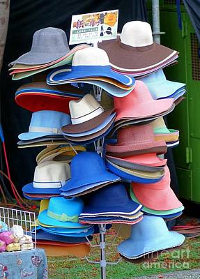 Photograph - Selling Hats Made From Paper by Yali Shi