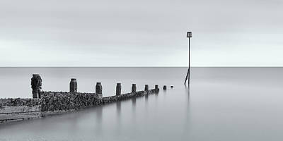 Photograph - Selsey Groyne On Pebble Beach In Black And White 2 by Angela Devaney