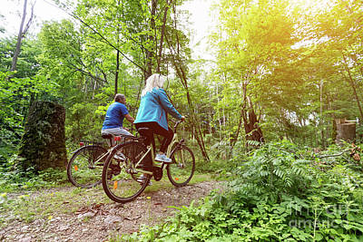 Photograph - Senior Couple Enjoying Their Ride In The Forest. by Michal Bednarek