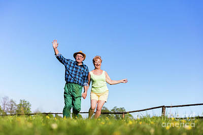 Photograph - Senior Couple Holding Hands And Running Outdoors. by Michal Bednarek
