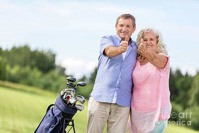 Firefighter Patents Royalty Free Images - Senior couple showing OK sign on a golf course. Royalty-Free Image by Michal Bednarek