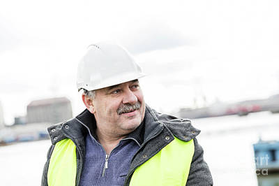 Photograph - Senior Engineer Builder At The Construction Site. by Michal Bednarek