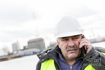 Photograph - Senior Engineer Builder On The Phone At Construction Site. by Michal Bednarek