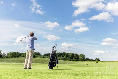 Playing Photograph - Senior Fit Man Hitting A Golf Ball. by Michal Bednarek
