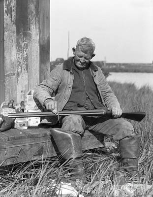 Photograph - Senior Man Cleaning Shotgun, C.1920-30s by H. Armstrong Roberts/ClassicStock
