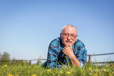 Photograph - Senior Man Lying On The Summer Field In Green Grass. by Michal Bednarek
