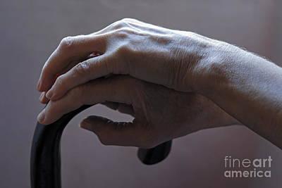 Senior Woman's Hands On Cane Art Print by Sami Sarkis