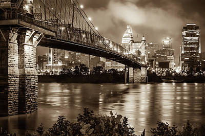 Photograph - Sepia Cincinnati Ohio Skyline And John Roebling Suspension Bridge by Gregory Ballos