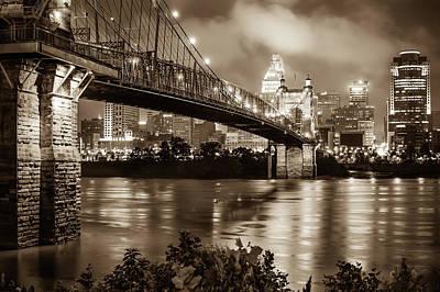 Photograph - Sepia Cincinnati Ohio Skyline And John Roebling Suspension Bridge by Gregory Ballos