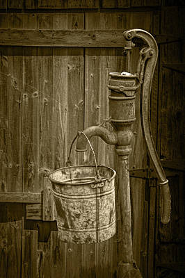 Photograph - Sepia Toned Rusty Water Pump With Bucket By An Old Wooden Barn by Randall Nyhof
