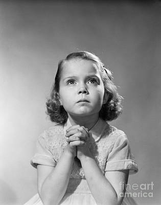 Serious Little Girl Praying, C.1950s Print by Debrocke/ClassicStock