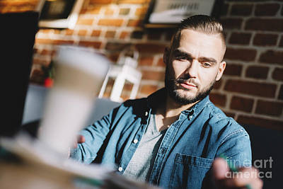 Photograph - Serious Young Man Sitting In A Cafe by Michal Bednarek