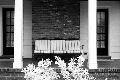 Settee On The Front Porch Art Print by John Rizzuto