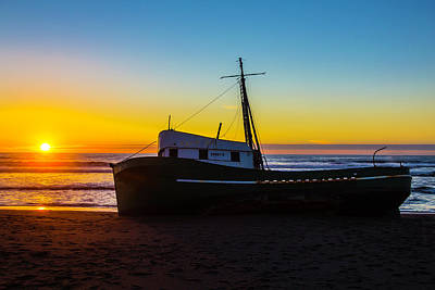 Setting Sun Beached Green Boat Print by Garry Gay