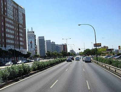 Photograph - Seville High Rise Buildings Along The Highway Spain by John Shiron