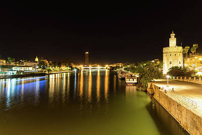 Photograph - Seville Night Magic - Torre Del Oro And Guadalquivir River In Bright Gold by Georgia Mizuleva